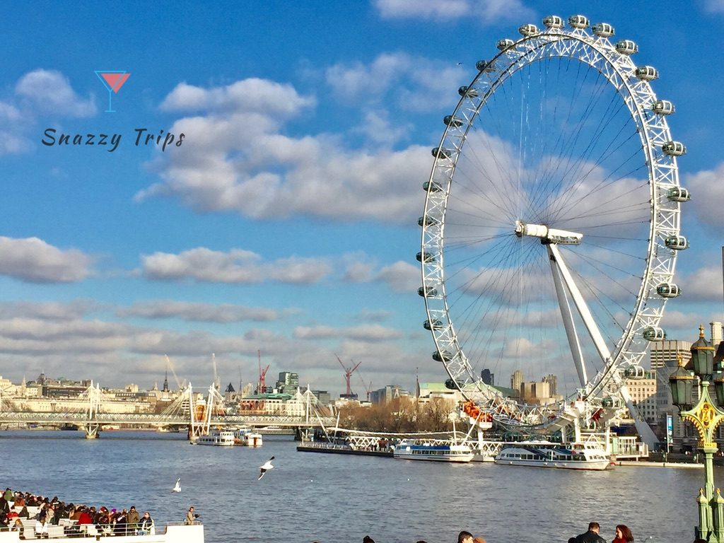 Large wheel next to river Thames