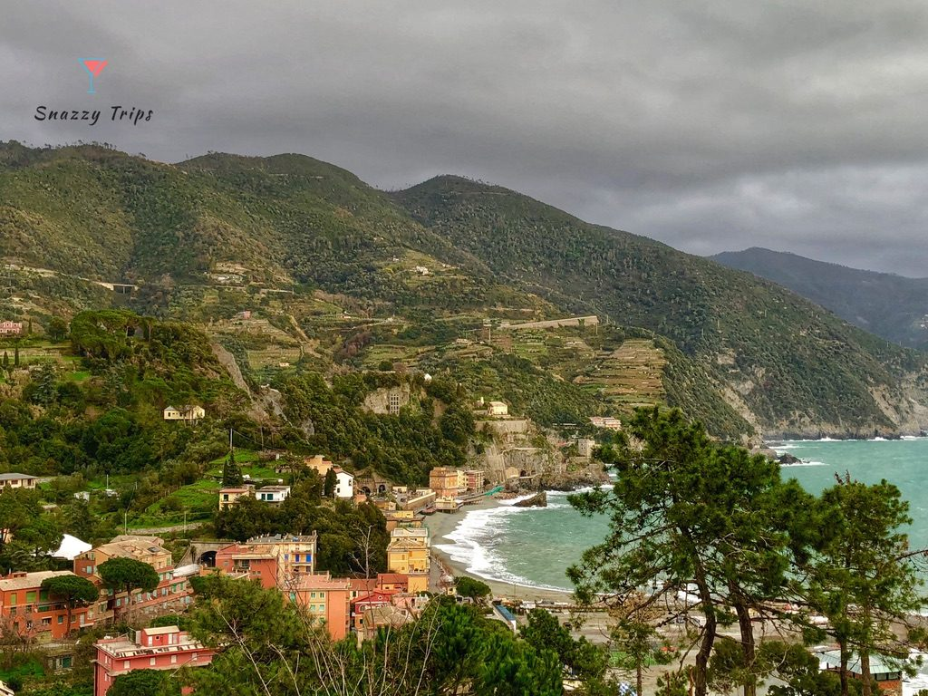 lovely view of resort town with hillside and sea