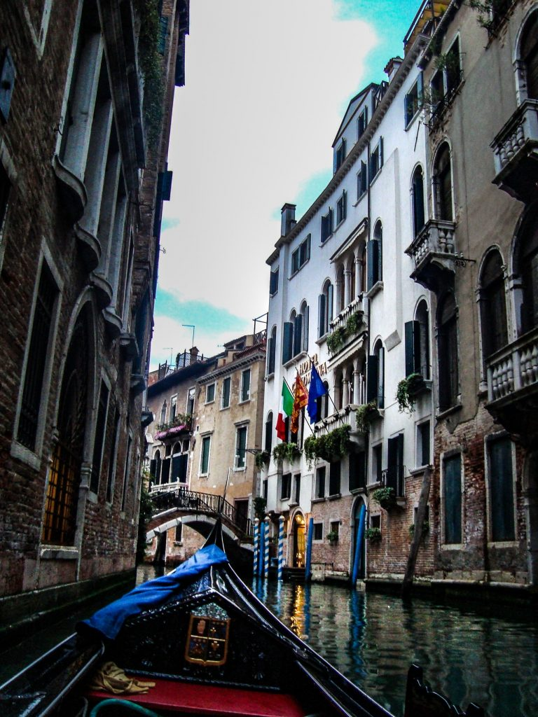 gondola on a canal with buildings on sides