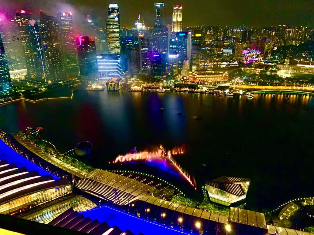 colourful city lights over water at night in Singapore