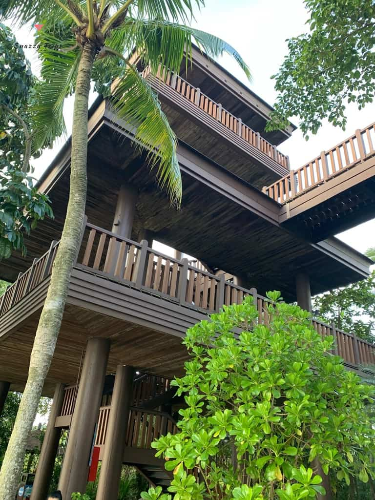 large wooden tree house with palms in Singapore